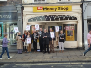 Group protesting outside The Money Shop in York