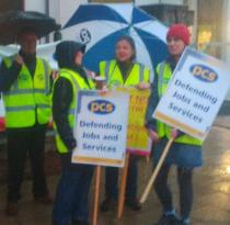 Four PCS Union pickets with signs