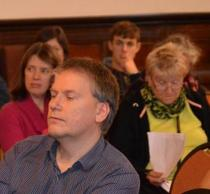 People listening to a speaker at our conference
