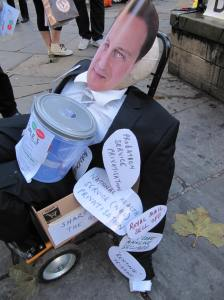 Dummy of David Cameron on trolley with labels attached