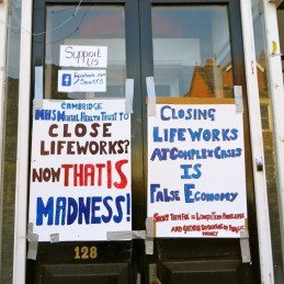 Signs on doors of occupied Cambridge mental health service